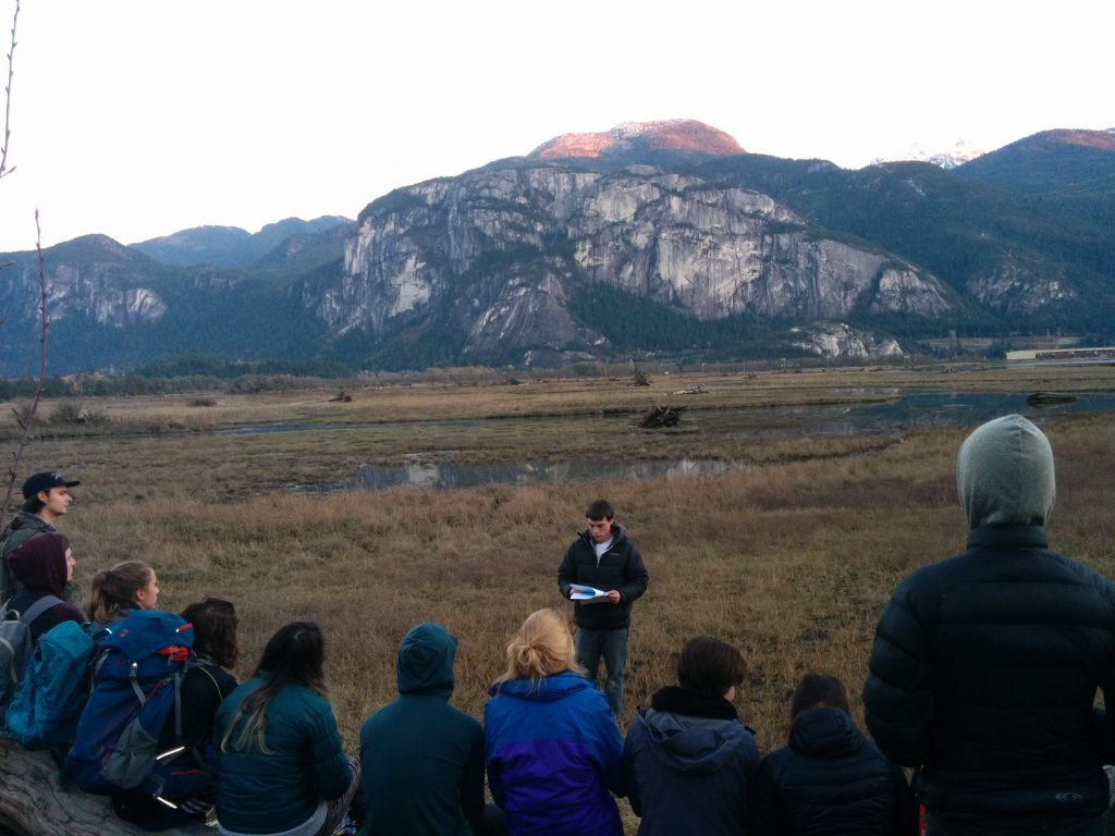 Capilano University students discuss the natural history of the Squamish Estuary. (Photo: Roy Jansen)